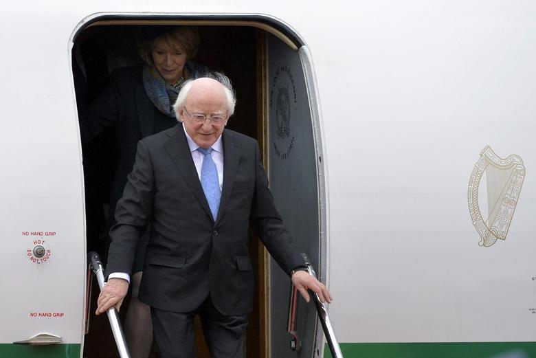 President of Ireland Michael Higgins (R) and his wife Sabina (back) arrive at Heathrow Airport near London, April 7, 2014. REUTERS/Toby Melville