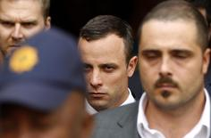 South African Olympic and Paralympic track star Oscar Pistorius (C) leaves after his trial at the high court in Pretoria April 8, 2014. REUTERS/Siphiwe Sibeko