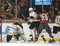 Apr 8, 2014; Saint Paul, MN, USA; Minnesota Wild right Wing Jason Pominville (29) scores his second goal of the game on Boston Bruins goalie Tuukka Rask (40) tying the game at two eadh in the first period at Xcel Energy Center. Marilyn Indahl-USA TODAY Sports