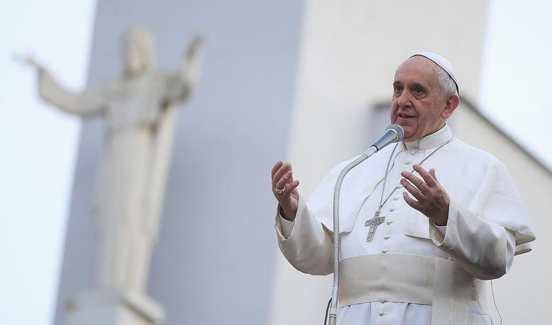 Pope Francis talks to the faithful at the end of a visit to parish San Gregorio Magno in Rome April 6, 2014. REUTERS/Tony Gentile