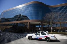 A police car is seen in front of an office building where police reported multiple stabbings to have occurred in Toronto, April 9, 2014. REUTERS/Mark Blinch