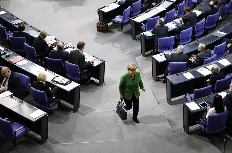 German Chancellor Angela Merkel leaves a debate about the surveillance activities of the U.S. National Security Agency during a session of the lower house of parliament, the Bundestag in Berlin, November 18, 2013. REUTERS/Thomas Peter/Files