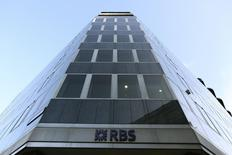 A sign is seen outside a Royal Bank of Scotland building in central London January 28, 2014. REUTERS/Paul Hackett
