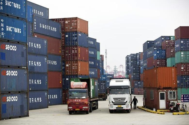 Trucks carrying containers drive at a port of Shanghai Free Trade Zone, February 11, 2014. REUTERS/Aly Song