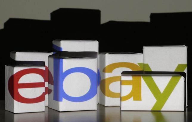 An eBay logo is projected onto white boxes in this illustration picture taken in Warsaw, January 21, 2014. RS/Kacper Pempel