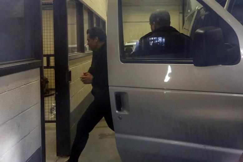 Suspended Senator Patrick Brazeau (L) is escorted into the court house in Gatineau, Quebec April 10, 2014. REUTERS/Chris Wattie