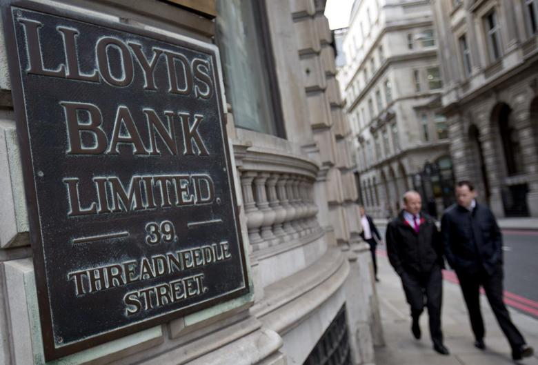 File photograph shows pedestrians walking past a branch of Lloyds Bank in the City London February 3, 2014. REUTERS/Neil Hall/Files
