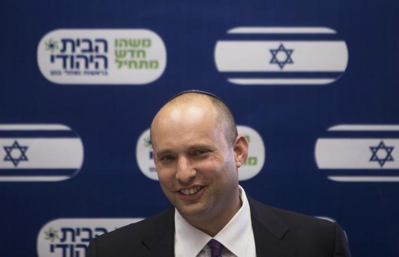 Naftali Bennett (C), smiles during a Jewish Home party meeting, at the Knesset, the Israeli parliament, in Jerusalem March 4, 2013. REUTERS/Ronen Zvulun