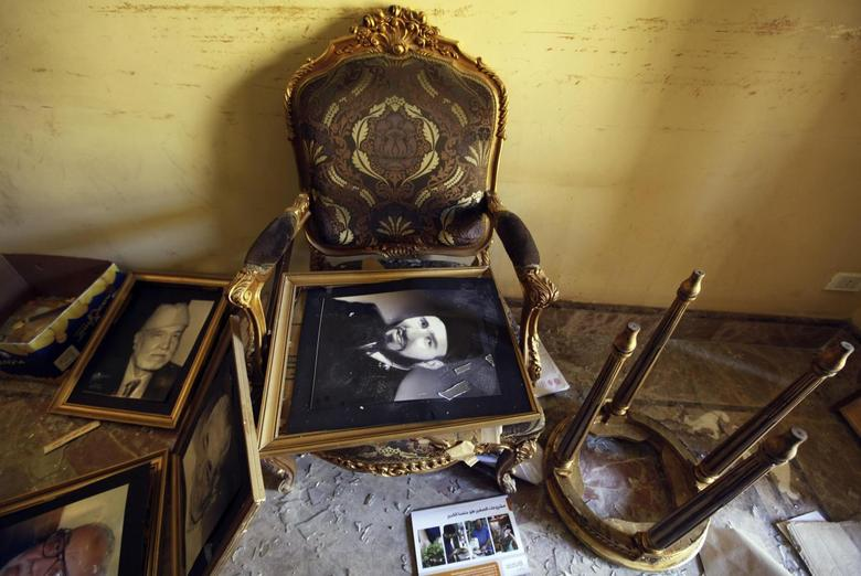 A framed portrait of Muslim Brotherhood founder Hassan Al-Banna lies on a chair in a ransacked room at the Muslim Brotherhood headquarters, in Cairo in this December 8, 2012 file picture. REUTERS/Amr Abdallah Dalsh/Files