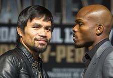 Boxer Manny Pacquiao (L) of the Philippines and undefeated WBO welterweight champion Timothy Bradley of the U.S. pose during a news conference at the MGM Grand Hotel and Casino in Las Vegas, Nevada April 9, 2014. REUTERS/Las Vegas Sun/Steve Marcus