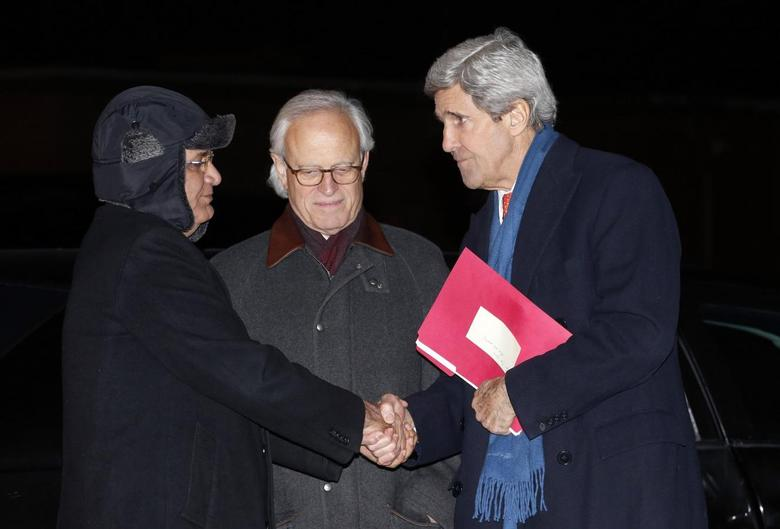 U.S. Secretary of State John Kerry (R) shakes hands with Palestinian lead negotiator Saeb Erekat (L) as he departs Joint Base Andrews in Washington enroute to Ukraine March 3, 2014 file photo. REUTERS/Kevin Lamarque