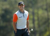 Northern Ireland's Rory McIlroy reacts after missing a putt on the 18th hole during the first round of the 2014 Masters golf tournament at the Augusta National Golf Club in Augusta, Georgia April 10, 2014. REUTERS/Brian Snyder