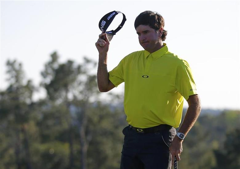 U.S. golfer Bubba Watson tips his hat after finishing the first round of the 2014 Masters golf tournament at the Augusta National Golf Club in Augusta, Georgia April 10, 2014. REUTERS/Brian Snyder