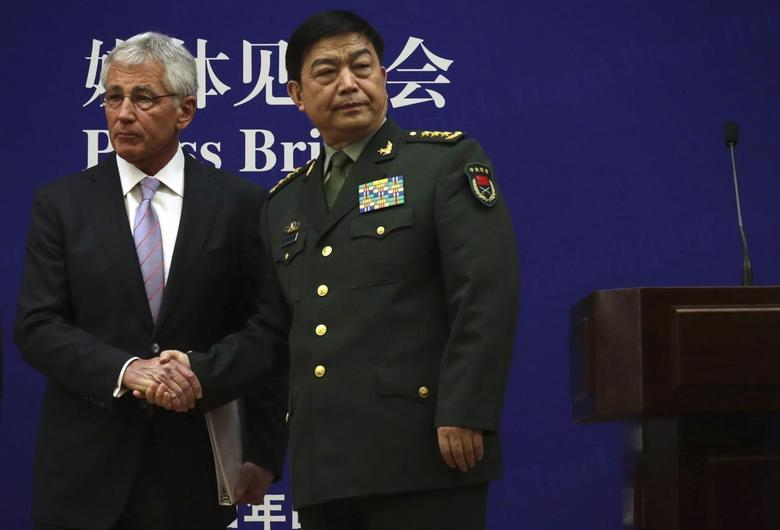 U.S. Secretary of Defense Chuck Hagel (L) shakes hands with Chinese Minister of Defense Chang Wanquan at the end of a joint news conference at the Chinese Defense Ministry headquarters in Beijing April 8, 2014. REUTERS/Alex Wong