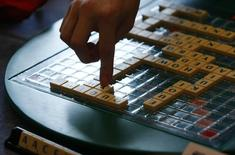 Players play scrabble at 2011 World Scrabble Championship in Warsaw October 15, 2011. REUTERS/Kacper Pempel