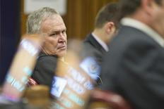 Defence lawyer Barry Roux listens as Prosecutor Gerrie Nel cross-examines Olympic and Paralympic track star Oscar Pistorius in the North Gauteng High Court in Pretoria, April 11, 2014. REUTERS/Craig Nieuwenhuizen/Pool