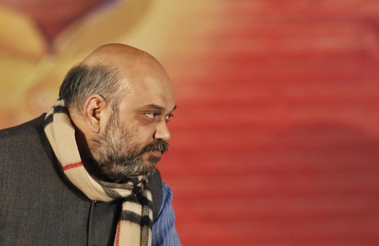Amit Shah, a leader of India's main opposition Bharatiya Janata Party (BJP) attends his party's national council meeting at Ramlila ground in New Delhi January 18, 2014. REUTERS/Ahmad Masood