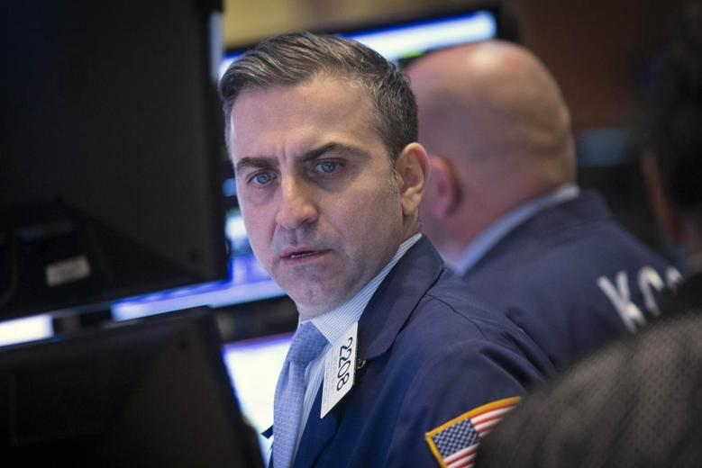 Traders work on the floor of the New York Stock Exchange April 11, 2014. REUTERS/Brendan McDermid