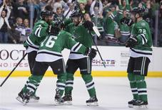 Apr 11, 2014; Dallas, TX, USA; Dallas Stars defenseman Trevor Daley (6) and left wing Ryan Garbutt (16) and defenseman Alex Goligoski (33) and Dallas Stars right wing Erik Cole (72) celebrate Goligoskis goal against St. Louis Blues goalie Ryan Miller (not pictured) during the third period at the American Airlines Center. The Stars shut out the Blues 3-0 and clinched the final playoff spot in the western conference. Mandatory Credit: Jerome Miron-USA TODAY Sports