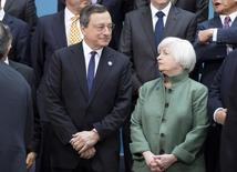 President of the European Central Bank Mario Draghi and U.S. Federal Reserve chair Janet Yellen speak before the G20 finance ministers and central bankers family portrait during the IMF/World Bank 2014 Spring Meeting in Washington April 11, 2014. REUTERS/Joshua Roberts