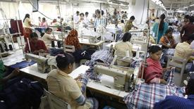 Employees work in a factory of Babylon Garments in Dhaka January 3, 2014. REUTERS/Andrew Biraj