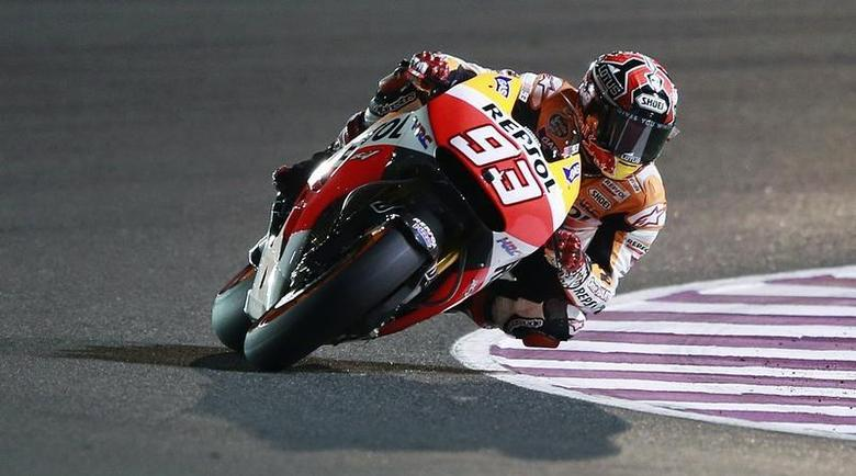 Honda MotoGP rider Marc Marquez of Spain rides his bike during a free practice session at the MotoGP World Championship at the Losail International circuit in Doha March 22, 2014. REUTERS/Mohammed Dabbous