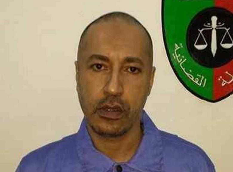 Saadi Gaddafi, son of Muammar Gaddafi, looks on inside a prison in Tripoli in this handout photograph provided by the prison's relations department on March 6, 2014. REUTERS/Prison Media Office/Handout via Reuters