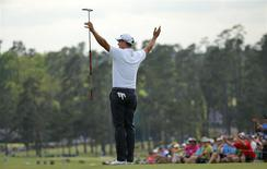 Former Masters champion Adam Scott of Australia celebrates as he finishes play during the final round of the Masters golf tournament at the Augusta National Golf Club in Augusta, Georgia April 13, 2014. REUTERS/Brian Snyder