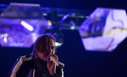 Lead vocalist Win Butler of rock band Arcade Fire performs at the Coachella Valley Music and Arts Festival in Indio, California April 13, 2014. REUTERS/Mario Anzuoni