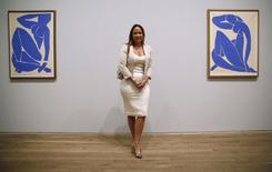 "Sophie Matisse, great granddaughter of Henri Matisse, poses with his artwork ""Blue Nude III"" (Nu Bleu III) (L) and ""Blue Nude II"" (Nu Bleu II) at the Tate Modern gallery in London April 14, 2014. REUTERS/Luke MacGregor"