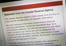 """The Canada Revenue Agency website is seen on a computer screen displaying information about an internet security vulnerability called the """"Heartbleed Bug"""" in Toronto, April 9, 2014. REUTERS/Mark Blinch"""