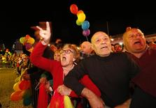 Gay rights activists jeer at opposition members of parliament, who abstained during a vote to recognise same-sex partnerships, in Valletta April 14, 2014. REUTERS/Darrin Zammit Lupi