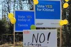 Protest signs are shown in the town of Kitimat, British Columbia April 12, 2014. REUTERS/Julie Gordon