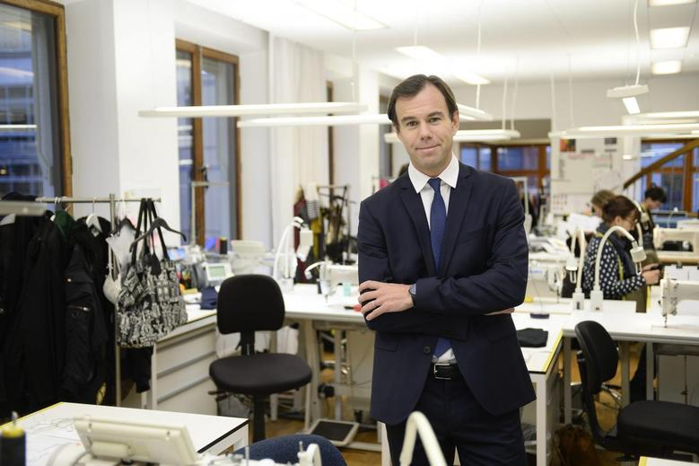 Swedish retailer Hennes & Mauritz Chief Executive Karl-Johan Persson poses for pictures at the company's office in Stockholm January 30, 2014. REUTERS/Leif R Jansson/TT News Agency