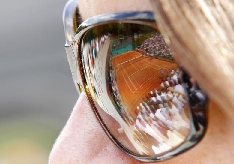 A spectator watches a match at the French Open tennis tournament at Roland Garros in Paris, May 28, 2010. REUTERS/Pascal Rossignol