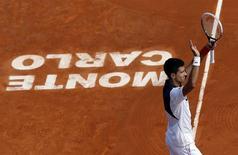 Novak Djokovic of Serbia celebrates after defeating Albert Montanes of Spain during the Monte Carlo Masters in Monaco April 15, 2014. REUTERS/Eric Gaillard