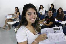 (Front row to back, L-R) Brazilian students Sara Morais, Claudio Thalles, Mariana Soares, Maria Clara, Monalisa Feitosa and Maria Laura pose for a photo inside the study hall of a college preparatory school in Brasilia, April 14, 2014. REUTERS/Joedson Alves