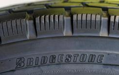 A tyre of Bridgestone Corp is displayed at its headquarters in Tokyo February 19, 2009. REUTERS/Kim Kyung-Hoon