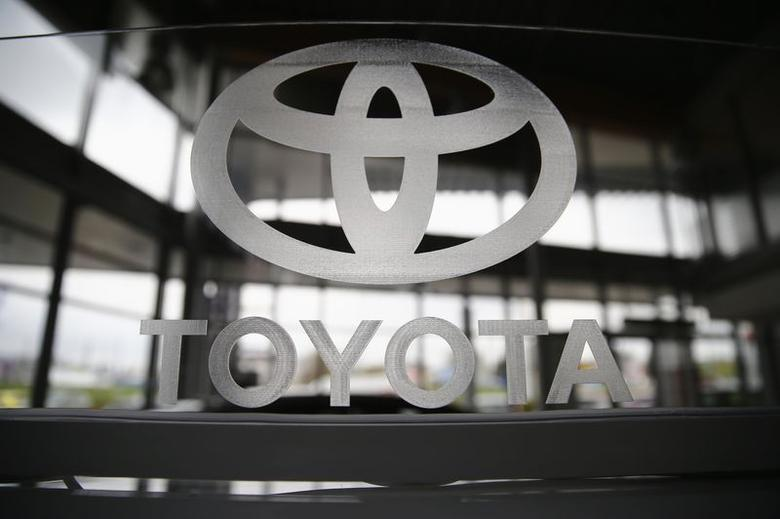 A Toyota logo is seen in a showroom at a Toyota dealership in Warsaw in this April 11, 2014 file photo. REUTERS/Kacper Pempel/Files