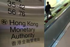 A security guard walks past a directory board of Hong Kong Monetary Authority (HKMA) in Hong Kong December 20, 2012. REUTERS/Tyrone Siu