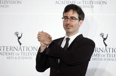 Comedian John Oliver poses for photographers backstage during the 41st International Emmy Awards in New York, November 25, 2013. REUTERS/Carlo Allegri