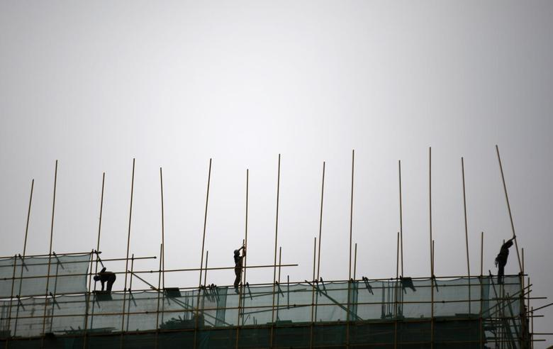 Labourers work at a construction site in Beijing, April 16, 2014. REUTERS/Kim Kyung-Hoon