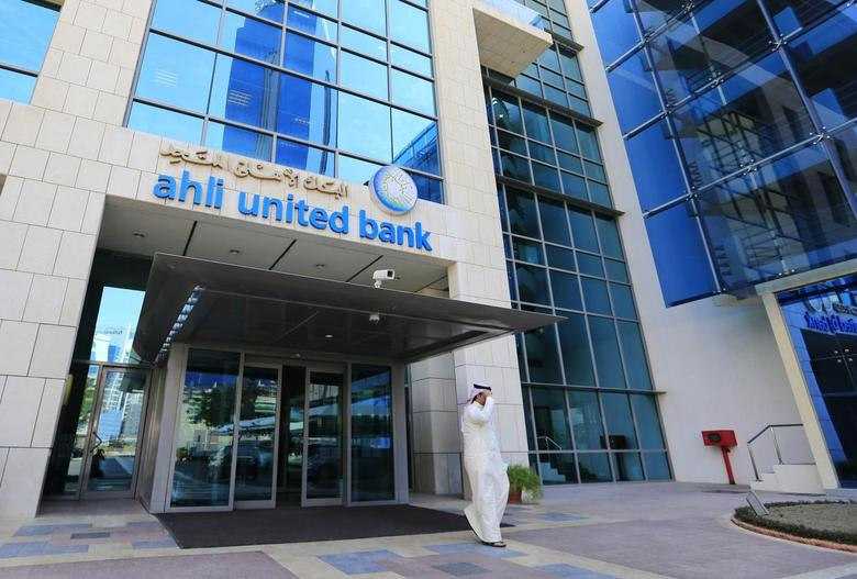 A customer walks out from the main entrance to Ahli United Bank's headquarters in Manama October 30, 2013. REUTERS/Hamad I Mohammed