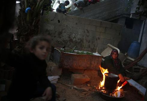 Cut off from the world, Gazans consumed by poverty