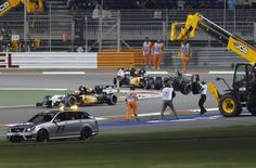 The car of Sauber Formula One driver Esteban Gutierrez of Mexico is removed from the track after his collision with Lotus Formula One driver Pastor Maldonado of Venezuela during the Bahrain F1 Grand Prix at the Bahrain International Circuit (BIC) in Sakhir, south of Manama April 6, 2014. REUTERS/Hamad I Mohammed