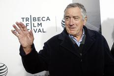 Robert De Niro waves upon arriving for the 2014 Tribeca Film Festival opening night screening of 'Time Is Illmatic' in New York April 16, 2014. REUTERS/Shannon Stapleton