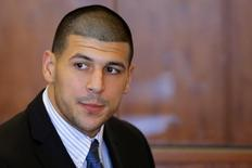 Aaron Hernandez, former player for the NFL's New England Patriots football team, attends a pre-trial hearing at the Bristol County Superior Court in Fall River, Massachusetts October 9, 2013, in connection with the death of semi-pro football player Odin Lloyd in June. Hernandez, who was a rising star in the NFL before his arrest and release by the Patriots, has pleaded not guilty. REUTERS/Brian Snyder