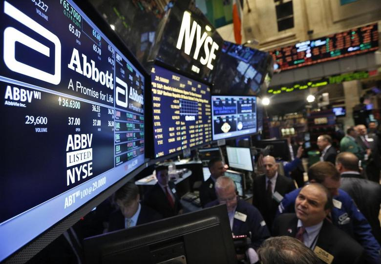 Traders gather at the booth that trades Abbott Laboratories on the floor of the New York Stock Exchange in this file photo taken December 10, 2012. REUTERS/Brendan McDermid/Files