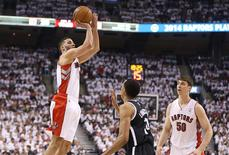 Apr 19, 2014; Toronto, Ontario, CAN; Toronto Raptors guard Greivis Vasquez (21) hits a three-pointer against the Brooklyn Nets in game one during the first round of the 2014 NBA Playoffs at Air Canada Centre. The Nets beat the Raptors 94-87. Mandatory Credit: Tom Szczerbowski-USA TODAY Sports