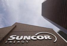 The Suncor Energy sign is seen outside Suncor's head office in Calgary, Alberta, October 2, 2009. REUTERS/Todd Korol